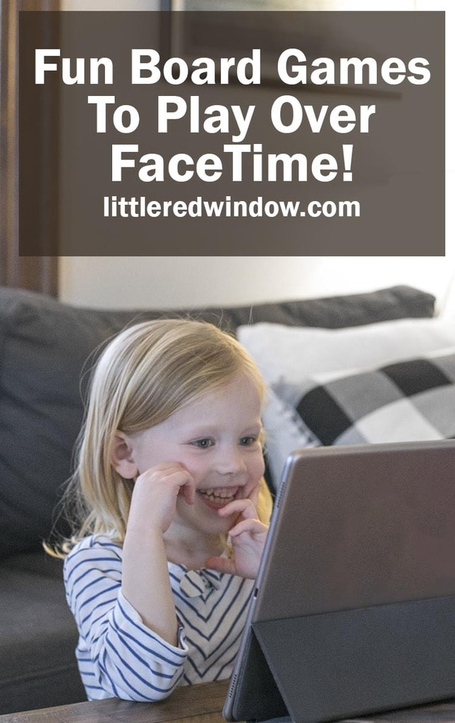 Smiling girl talking to someone on a video screen
