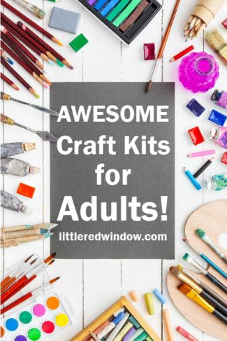 Tons of colorful craft supplies on a white table with the words AWESOME CRAFT KITS FOR ADULTS in the center