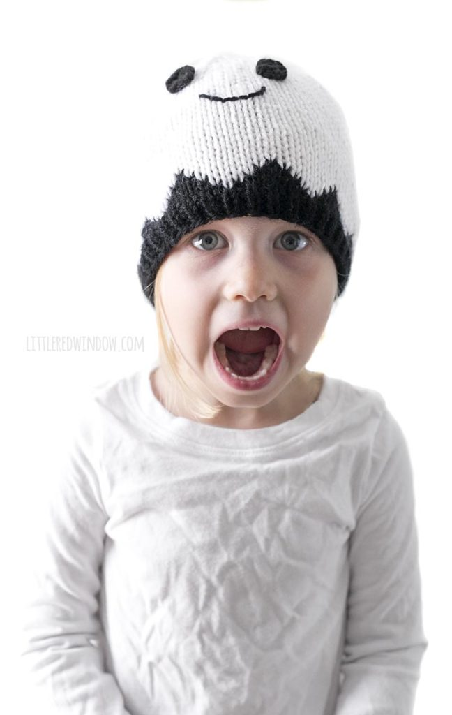 Little girl wearing white ghost hat and making surprised face
