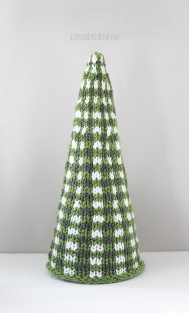 large green and white knit christmas tree on a white table