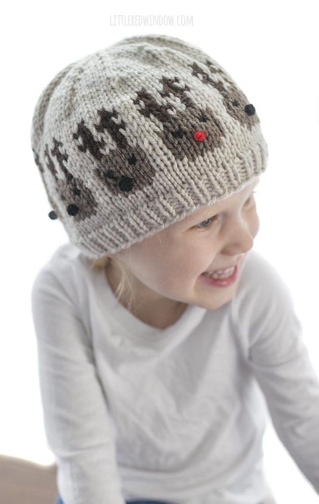 little girl wearing team of reindeer hat knitting pattern