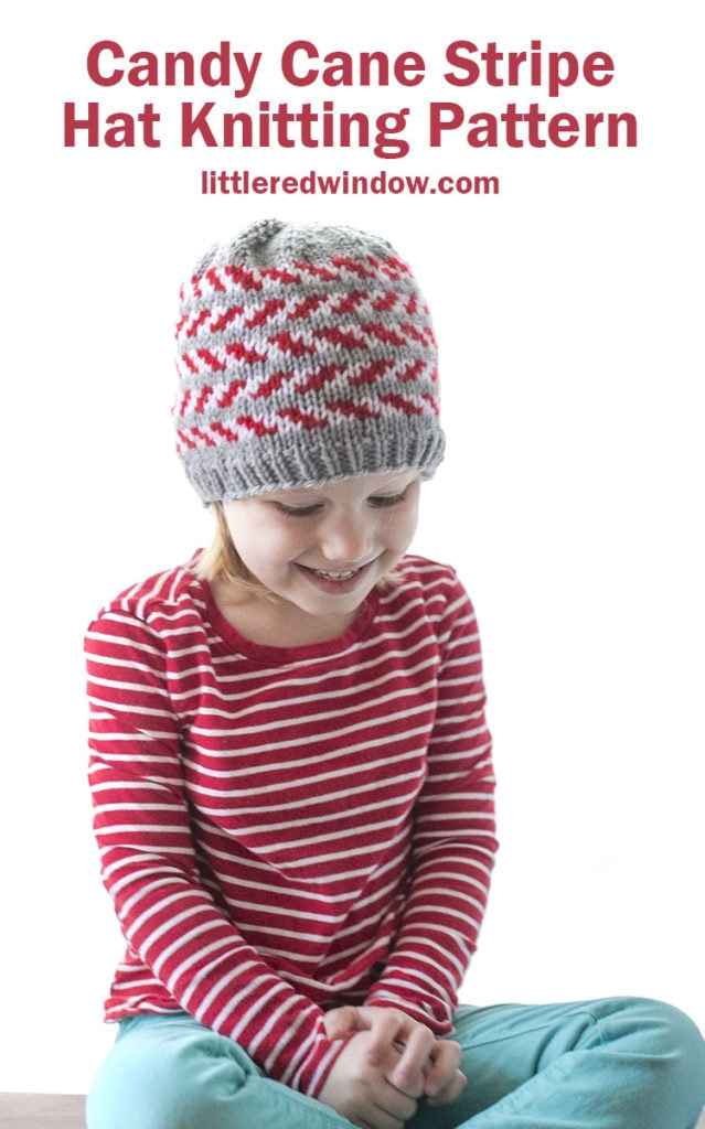 The candy cane stripe hat knitting pattern is an adorable Christmas baby hat with alternating candy cane stripes on a gray background, it's the perfect holiday knit!