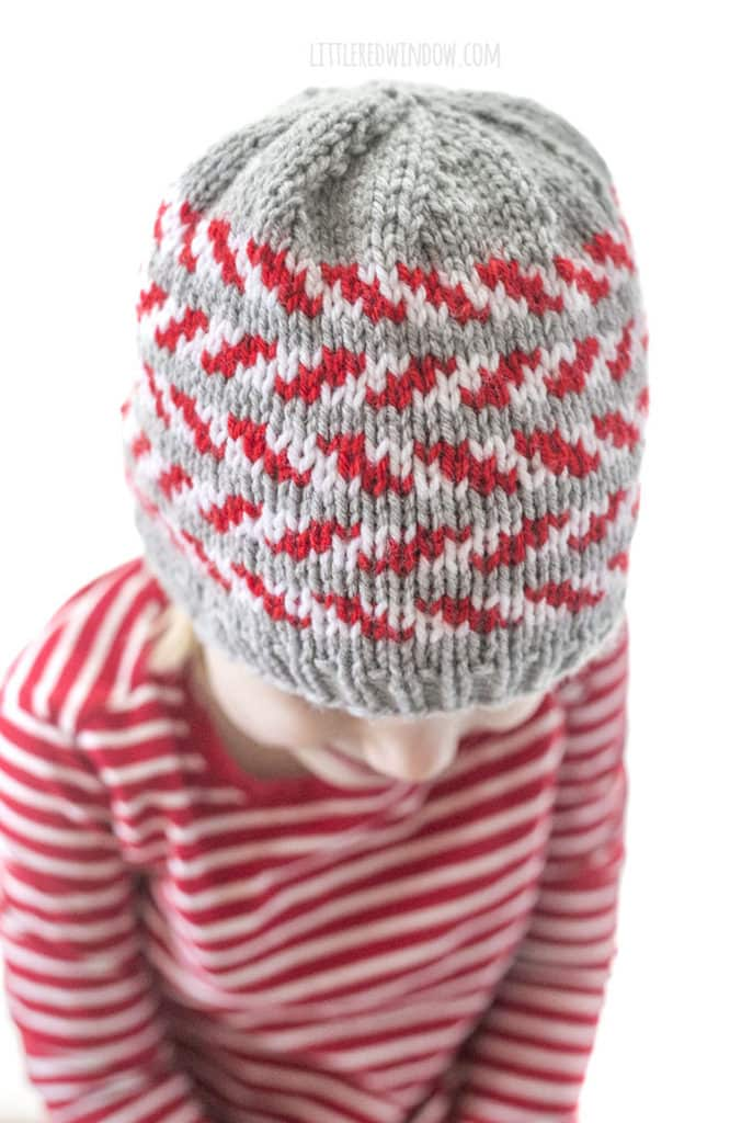 closeup of top of knit candy cane stripe hat
