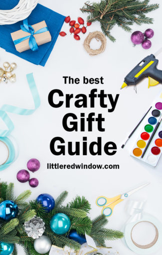 white background with watercolors blue ribbon Christmas ornaments and greenery a glue gun and the words the best crafty gift guide