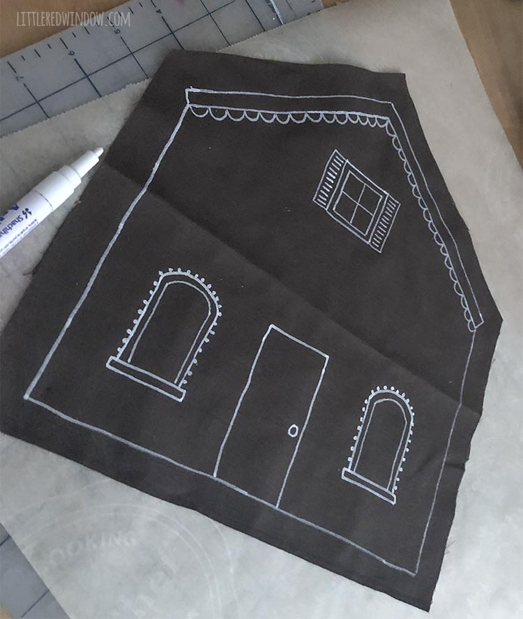 progress shot of brown fabric gingerbread house shape being decorated