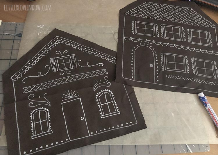 two flat pieces of brown fabric decorated like gingerbread houses