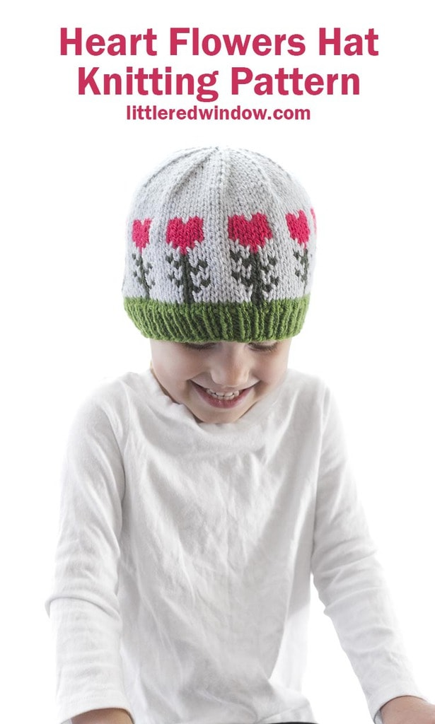 This cute heart flowers hat has bright colorful heart shaped flowers knit around the brim, perfect for Valentine's day for your baby or toddler!