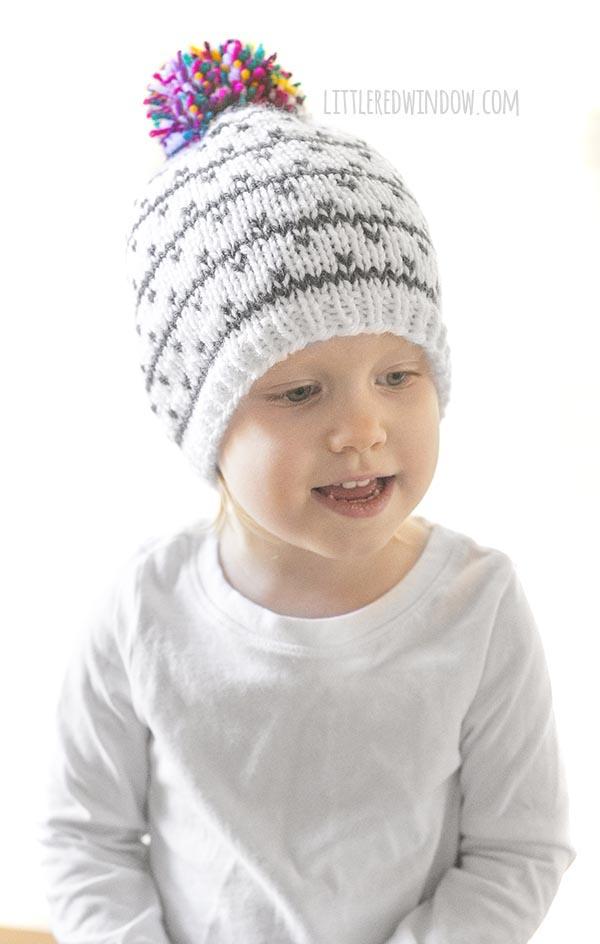 smiling girl wearing kaleidoscope hat knitting pattern