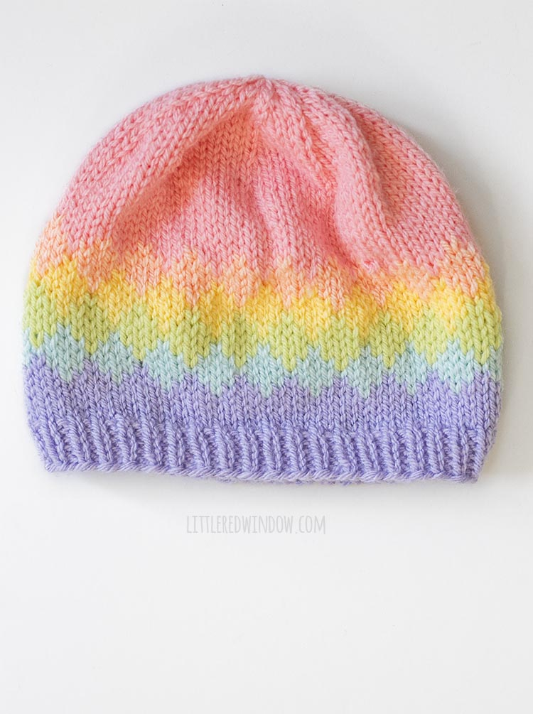 Overhead view of Knit hat with six rainbow colors in a diamond pattern