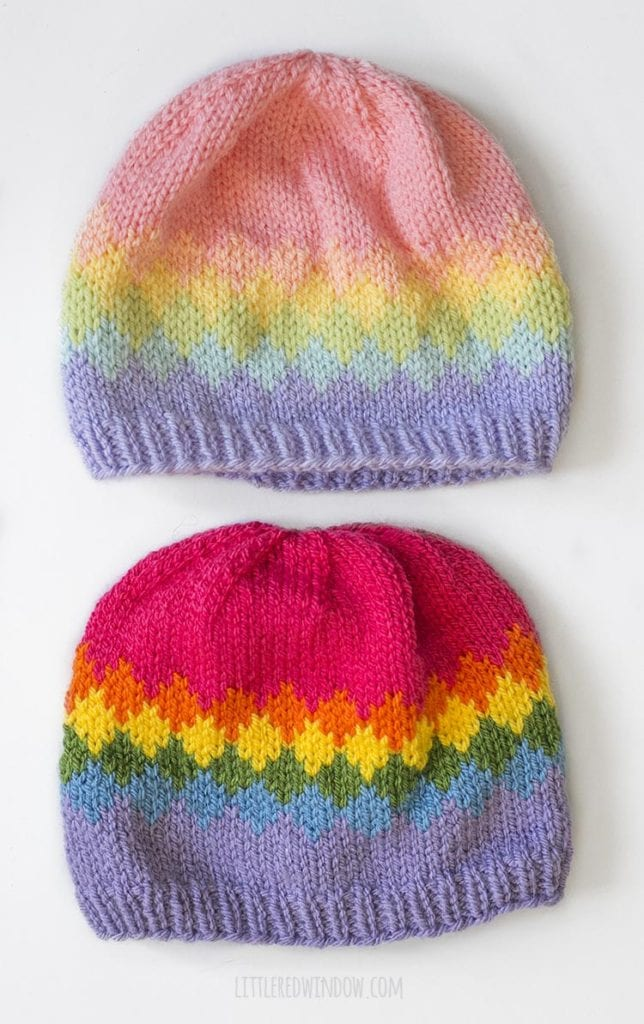 Two versions of the diamond rainbow fade hat knitting pattern one knit in pastel rainbow shades and one knit bright rainbow shades