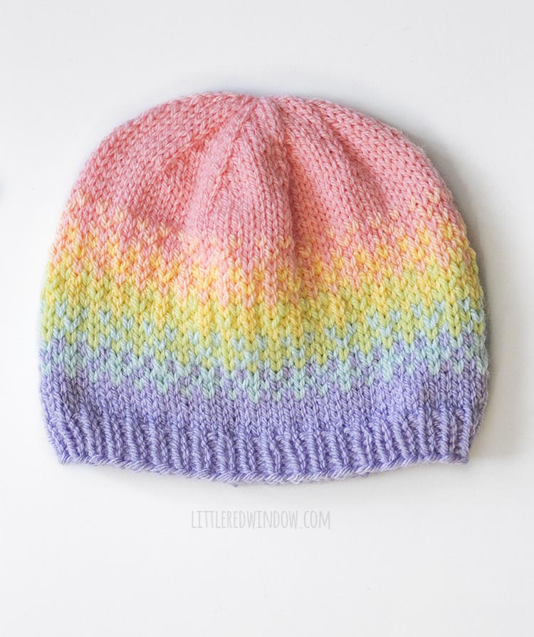 dotted fade hat overhead view from rainbow fades hats knitting pattern on white background