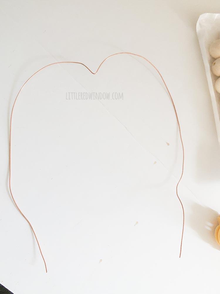 long piece of 20 gauge wire bent into a heart shape