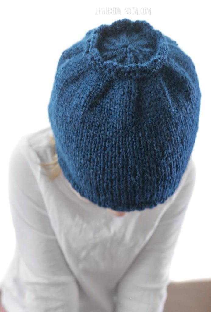 top view of girl wearing blueberry knit hat