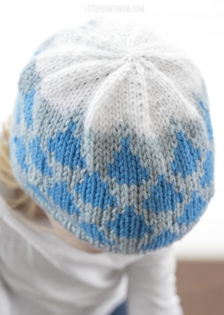 top view of raindrop hat knitting pattern on little girl