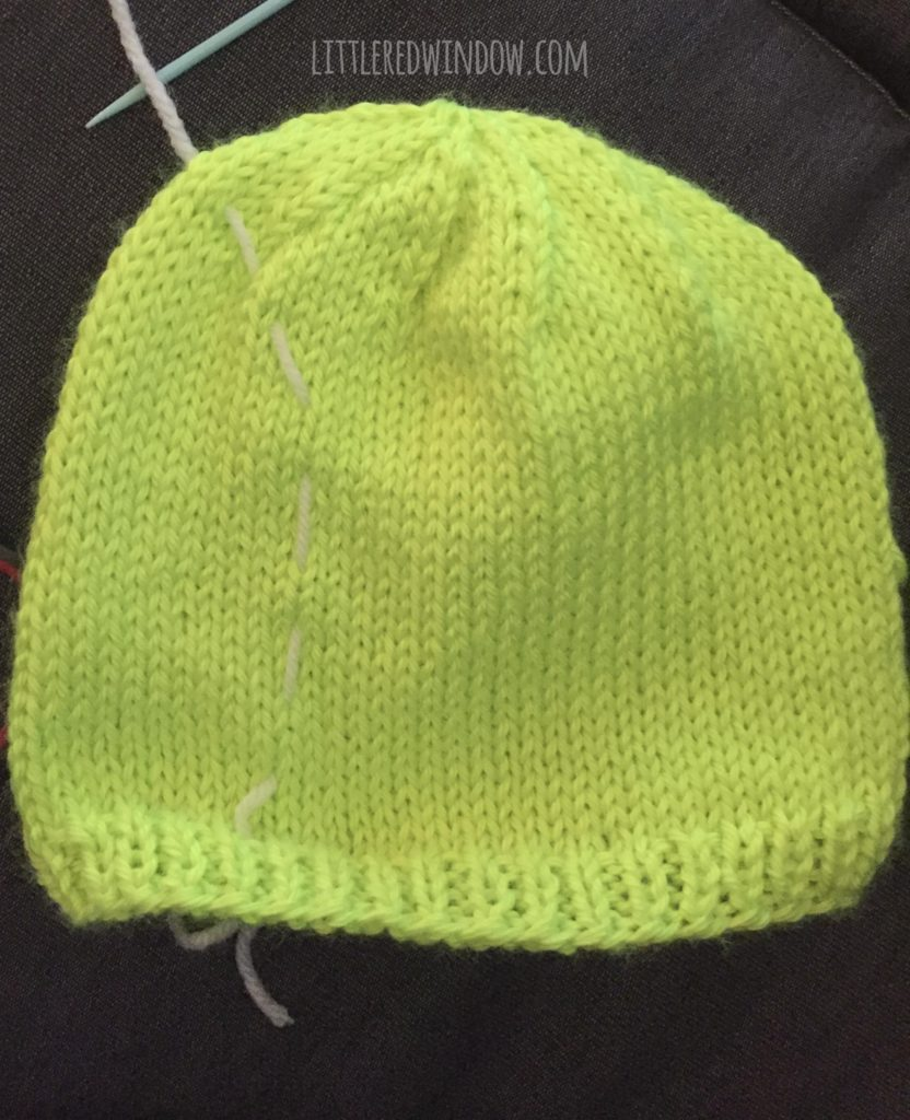 bright green tennis ball hat with a line of white basting stitches