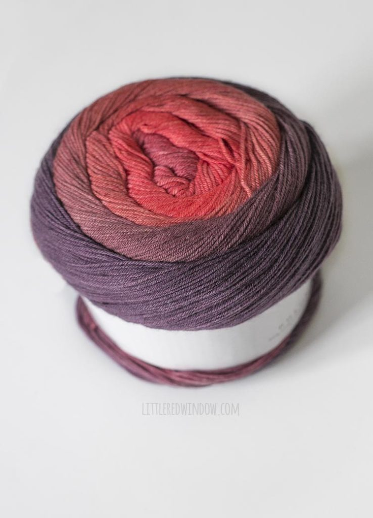 purple and pink wound cake of yarn