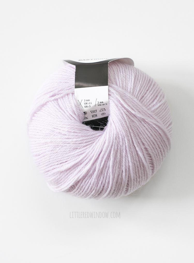 light purple wound donut ball of yarn on white background