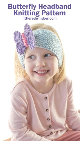 smiling girl in pink shirt wearing light blue seed stitch knit headband with a purple and pink knit butterfly perched on top