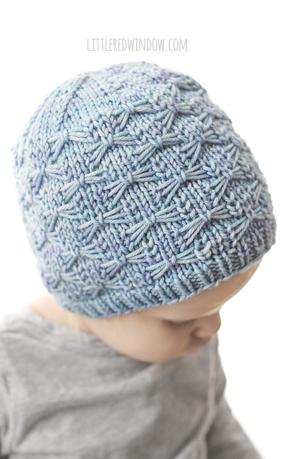 side view of light blue butterfly stitch hat
