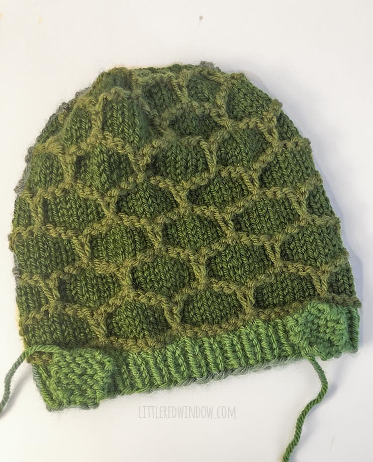 green turtle hat with two feet pieces placed on top