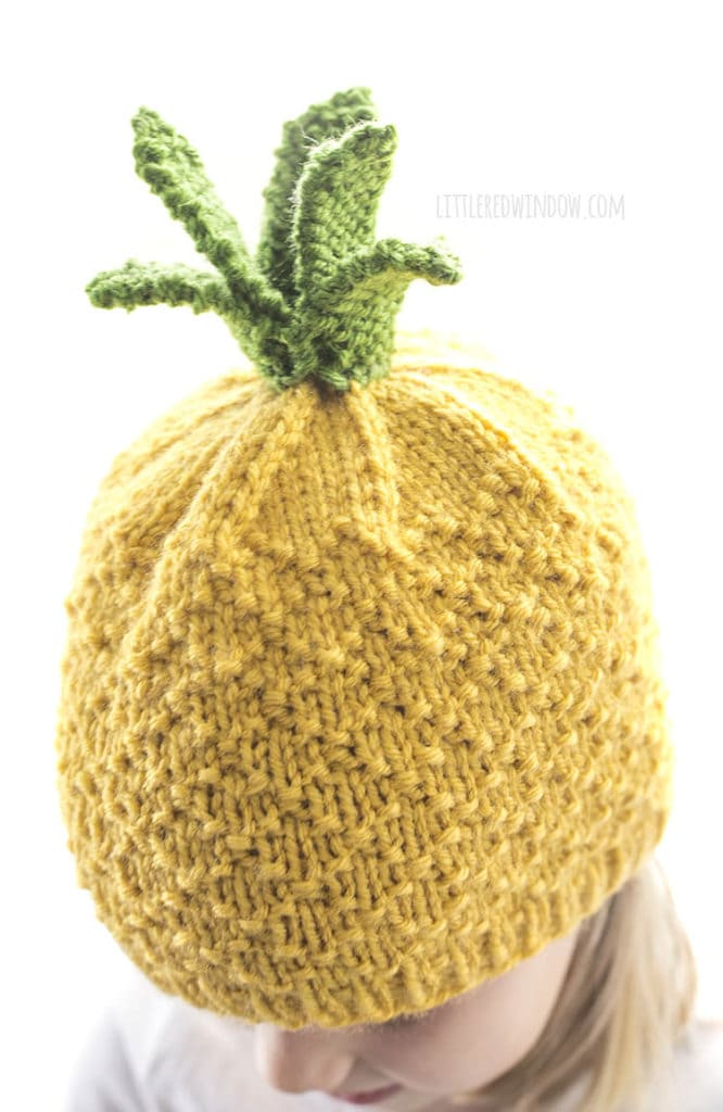 closeup of pineapple knit hat with diamond knit texture