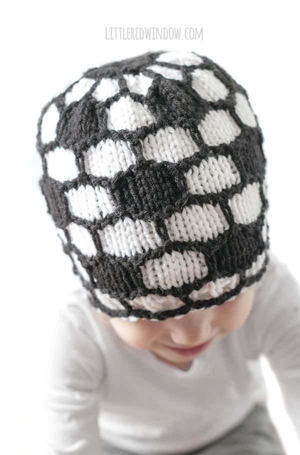 closeup of knit stitches on a black and white knit soccer ball hat