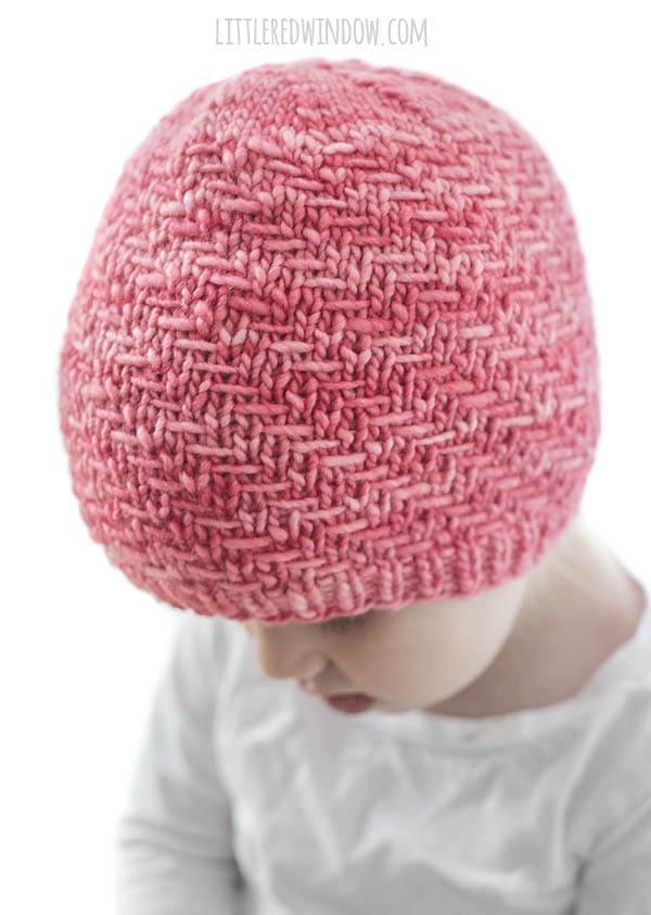 side view closeup of diagonal weave hat knit stitch in bubblegum pink