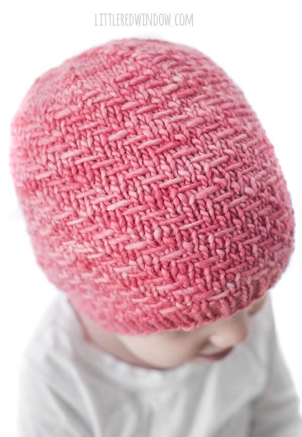 closeup of diagonal weave stitch on a bubblegum pink hat