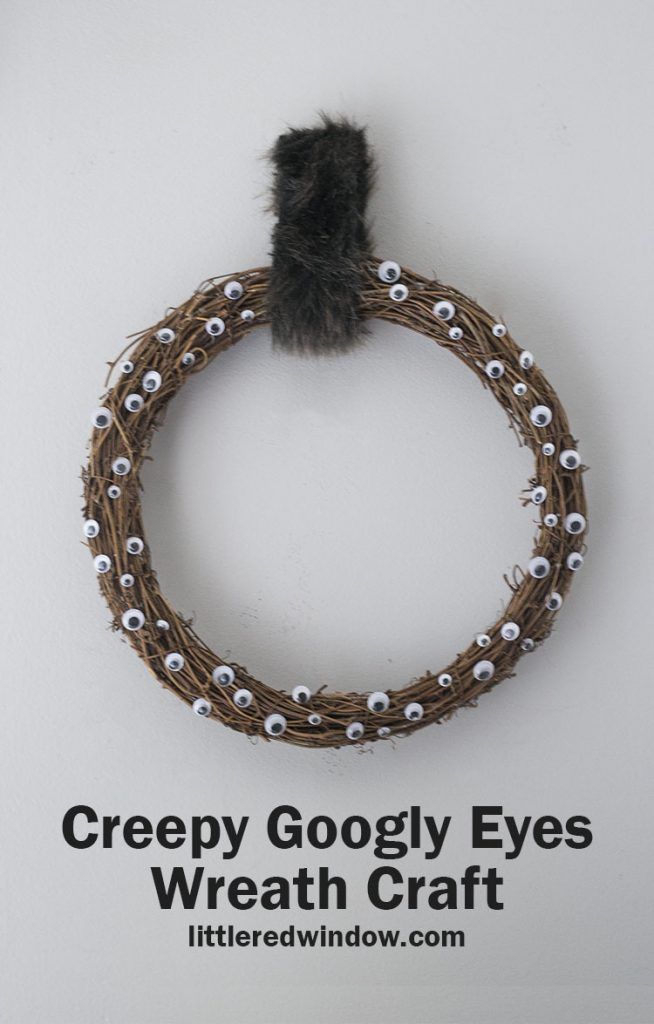 This quick and easy creepy google eyes wreath craft is the perfect Halloween craft to make for your home! Kids can help too!