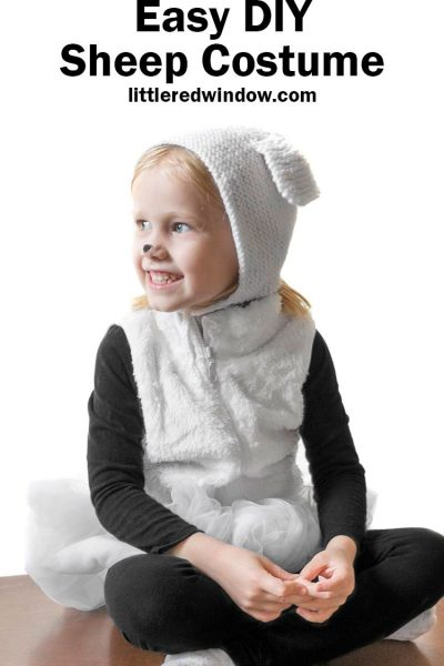 little girl in furry white vest and sheep bonnet with the words easy diy sheep costume in black